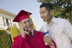 Senior Male Graduate On Call Stock Images