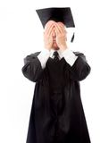Senior male graduate hiding his face Royalty Free Stock Images