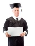 Senior male graduate holding blank sheets of paper Stock Photography