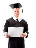 Senior male graduate holding blank sheets of paper Stock Images