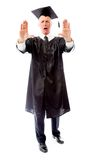 Senior male graduate holding his hand and yelling stop Royalty Free Stock Images