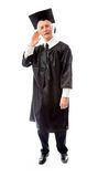 Senior male graduate listening with hand to ear Stock Photos