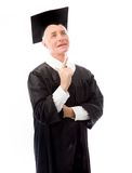Senior male graduate looking and pointing upward Stock Image