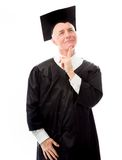 Senior male graduate looking up and daydreaming Royalty Free Stock Images