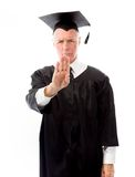 Senior male graduate making stop gesture Stock Photography