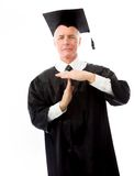 Senior male graduate making timeout gesture Stock Image