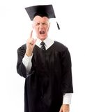 Senior male graduate scolding somebody Royalty Free Stock Photo