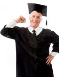 Senior male graduate showing off his muscles Stock Image