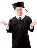 Senior male graduate shrugging Stock Image
