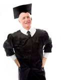 Senior male graduate standing with his arms akimbo Stock Photos