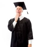 Senior male graduate yawning Stock Image