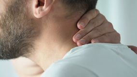 Senior male having neck ache during doctors visit, sharp sudden pain, therapy stock video