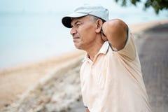 Senior male having neck pain royalty free stock image