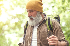 Senior male hiker feels fatigue Royalty Free Stock Photography