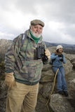 Senior Male Hiker Holding Binoculars Stock Images