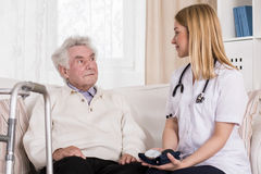 Senior male during medical consultation. Image of senior male during medical consultation with nice doctor Stock Photo