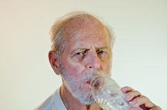 Senior Male Model Drinking Water Royalty Free Stock Photos