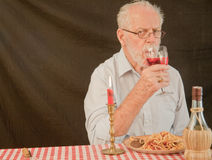 Senior Male Model Drinking Wine Stock Photography