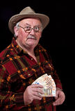 Senior male with money issues on black background Royalty Free Stock Photography