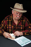 Senior male with money issues on black background Royalty Free Stock Image