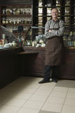 Senior Male Owner Standing In Shop Royalty Free Stock Images