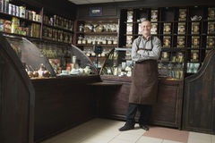 Senior Male Owner Standing In Shop. Full length portrait of senior male owner standing in shop stock image