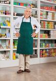 Senior Male Owner Standing In Supermarket Royalty Free Stock Photography