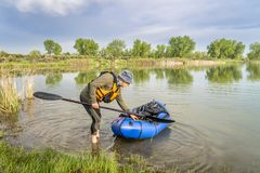 Senior male with a packraft Stock Image