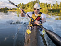 Senior male paddler in a fast kayak Stock Image