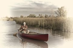 Afternoon canoe paddling on  a lake Royalty Free Stock Image