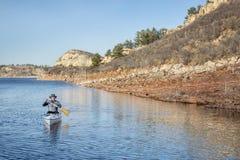 Senior male paddling canoe Royalty Free Stock Image