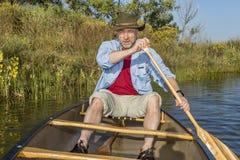 Senior male paddling canoe Royalty Free Stock Photos
