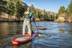 Stand up paddling on mountain river stock image