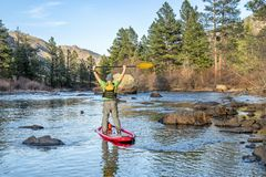 Stand up paddling on mountain river stock images