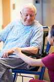 Senior Male Patient Being Pushed In Wheelchair By Nurse Royalty Free Stock Images
