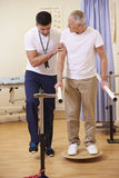 Senior Male Patient Having Physiotherapy In Hospital Stock Images
