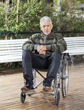 Senior Male Patient Sitting In Wheelchair At Lawn Royalty Free Stock Image
