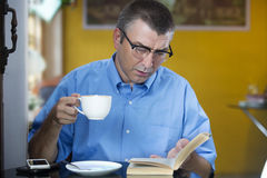 Senior male  reading a book Royalty Free Stock Image
