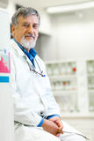 Senior male researcher carrying out scientific research in a lab Stock Photography