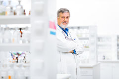 Senior male researcher carrying out scientific research in a lab Royalty Free Stock Images