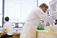 Senior male researcher in a lab Stock Photography