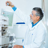 Senior male researcher  in a lab Royalty Free Stock Photography