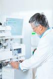 Senior male researcher  in a lab Stock Photo