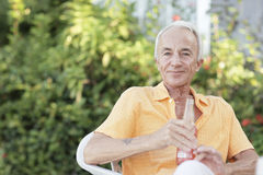 Senior male and a soda Royalty Free Stock Photo