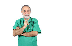 Senior male surgery operator doctor with green uniform portrait isolated on white Royalty Free Stock Photos