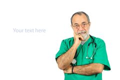 Senior male surgery operator doctor with green uniform standing isolated on white Stock Photos