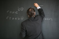 Senior male teacher teaching mathematics Royalty Free Stock Photography