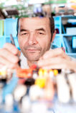 Senior male tech at work. Senior male tech tests electronic equipment Stock Photo
