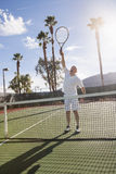 Senior male tennis player playing on court Royalty Free Stock Images