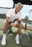 Senior Male Tennis Player Wearing Wristband Stock Photo
